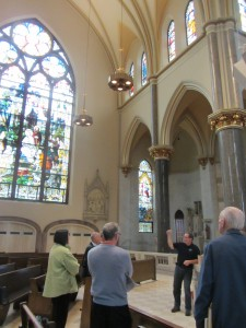Pastoral ministry assistants from the U.S. Jesuit provinces receive a tour of Church of the Gesu in Milwaukee, Wisconsin.